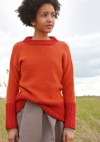 Orange-roter Pullover